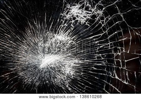 Abstract closeup shot of shattered glass. May have been struck by a bullet