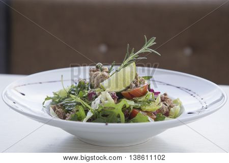 Tuna salad with vegetables on the plate.