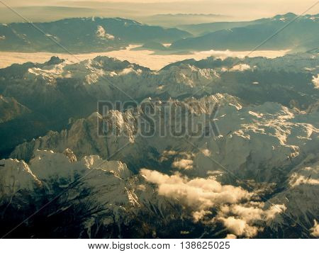 Aerial view of striking high mountains with snow