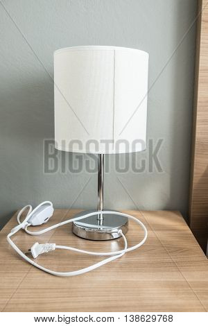 Modern table lamp on a bedside table