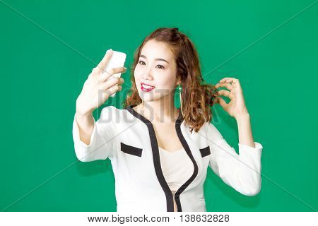 Asian Thai Girl Check Make Up Face With Mobile Phone