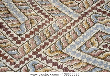 Closeup of mosaic floor of ancient roman villa with ancient geometrical ornament depicting labyrinth, archaeological park Tombs of Kings,Paphos,Cyprus,unesco heritage