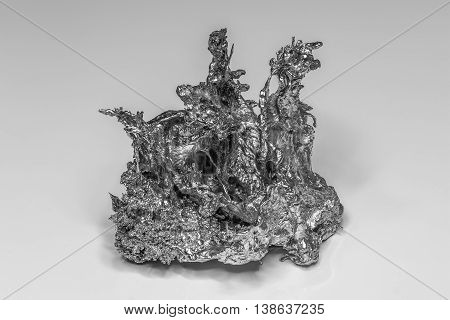 Nugget of a solidified Metall in black and white