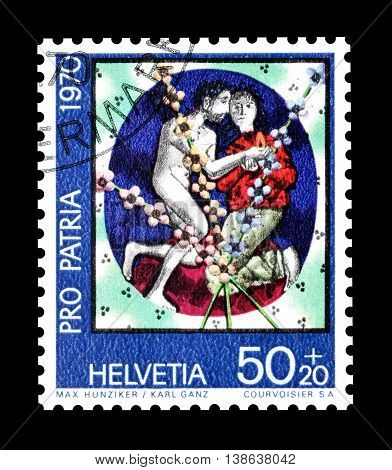 SWITZERLAND - CIRCA 1970 : Cancelled postage stamp printed by Switzerland, that shows Man and wife by Max Hunziker and Karl Ganz.