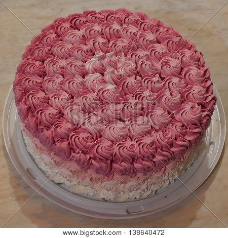 Ombre cake with a thick layer of pink cream