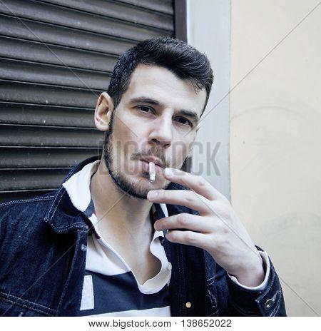 middle age man smoking cigarette on backjard, stylish tough guy, lifestyle people concept close up