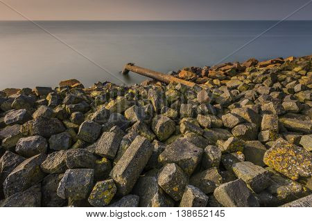 Waste Pipe Into Lake  IJsselmeer At Sunrise