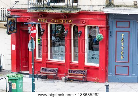 BATH SOMERSET UK - JULY 15 2016 The Curfew Ale House. Pub on Cleveland Place in the UNESCO World Heritage City of Bath in Somerset England