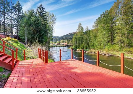 Red Walkout Deck With Staircase On River Bank