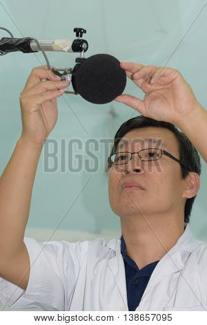 An acoustic engineer testing the microphone setup