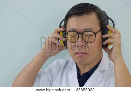 An acoustic engineer testing audio setup with a headphone