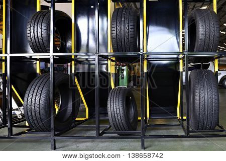 Tire rubber products , Group of new tires for sale at a tire store.