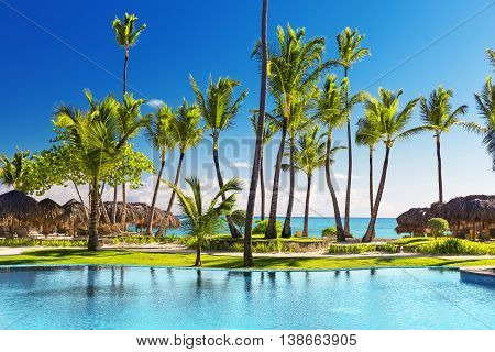 Tropical Beach Resort With Lounge Chairs And Umbrellas
