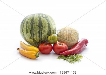 Stack of fresh summer vegetable siolated on white background