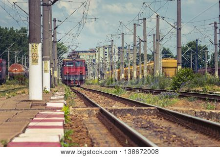 Train On Tracks. Railroad Tracks. Railway Station. Electrified Railway Track With Railway Signals