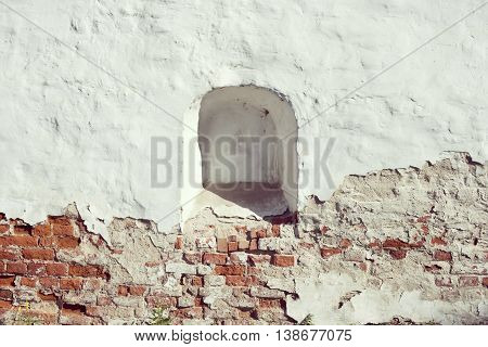 ancient weathered brick wall with walled loophole