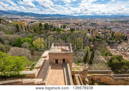 Panoramic view Granada town from the tower of Alcazaba, the military fortress of Alhambra de Granada, a World Heritage Site in Andalusia, Spain.
