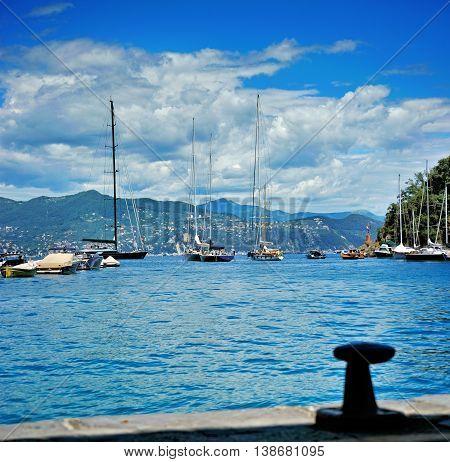 Sea coast with moor boats and yacht in Portofino Italy