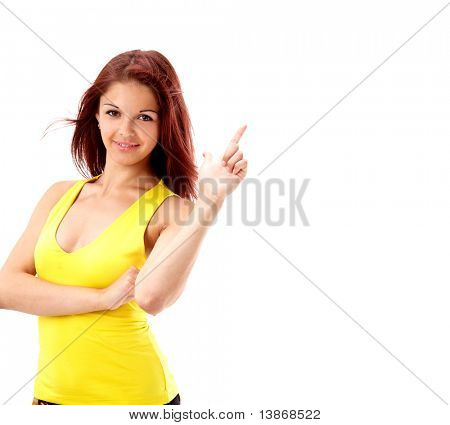 Young beautiful female executive pointing at copyspace