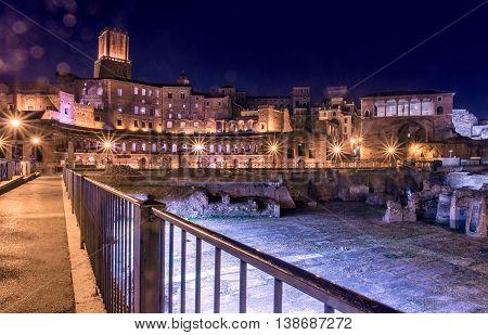 Night cityscape and view on Trajan's Market (Mercati Traianei) on the Via dei Fori Imperiali, in Rome, Italy