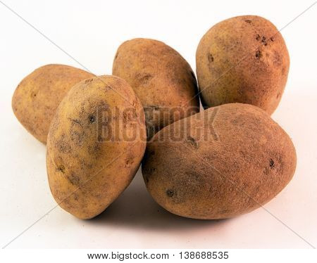 Russet Potatoes -  Closeup image of hearty, tasty, and nutritiously healthy, potatoes.