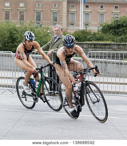 STOCKHOLM - JUL 02 2016: Two female triathlete cyclists Sarah True and Juri Ide in the Women's ITU World Triathlon series event July 02 2016 in Stockholm Sweden