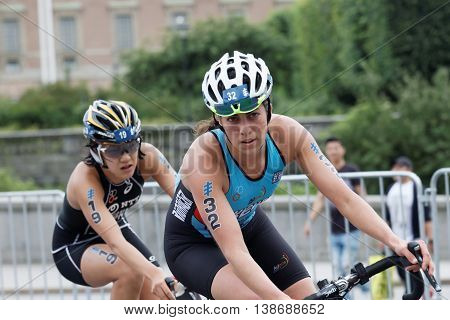 STOCKHOLM - JUL 02 2016: Close up of female triathlete cyclists Claire Michel and Yuko Takahashi in the Women's ITU World Triathlon series event July 02 2016 in Stockholm Sweden