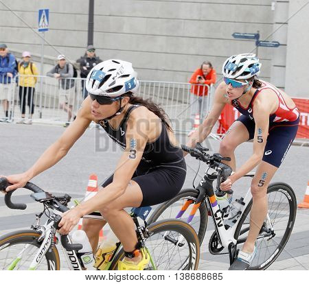 STOCKHOLM - JUL 02 2016: Cycling female triathletes Andrea Hewitt and Helen Jenkins fighting in the Women's ITU World Triathlon series event July 02 2016 in Stockholm Sweden