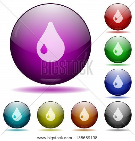 Set of color drop glass sphere buttons with shadows.