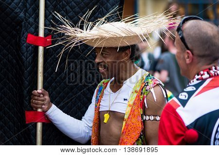BATH SOMERSET UK - JULY 16 2016 Man in straw hat. Bath Carnival procession around the streets of the city of Bath bringing a South American festival atmosphere to Somerset