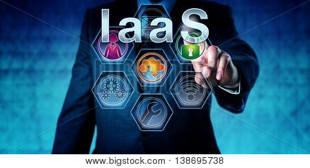 Manager is pressing IaaS on an interactive touch screen. Information technology concept for cloud computing and acronym for Infrastructure as a Service. Close up shot of business man in blue suit.
