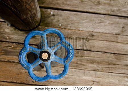 Blue Rusty Spigot At Marina