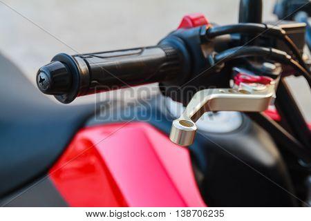 Close up of racing motorcycle handlebar and brake lever.