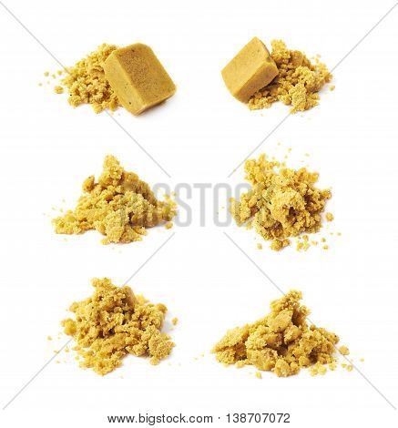 Crushed yellow bouillon stock broth cube isolated over the white background, set of six different foreshortenings