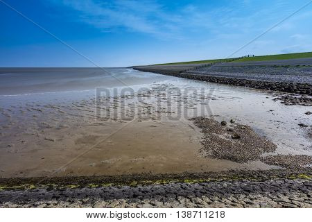 Wadden Sea And Dike In The Netherlands