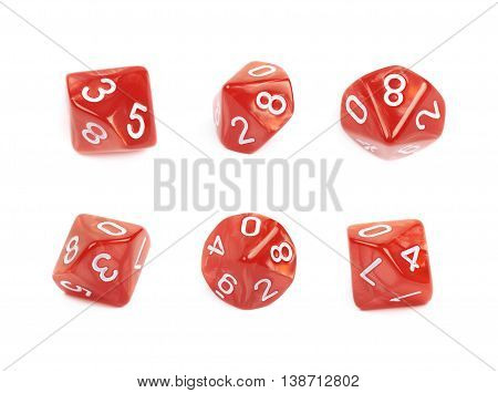 Red roleplaying polyhedral heptagonal trapezohedron gaming plastic dice isolated over the white background, set of six different foreshortenings