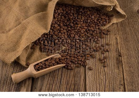 flavor of coffee and wooden background. flavor of coffee and wooden background.