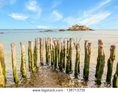 Breakwaters in high flow and Fort National. Seashore Saint-Malo, Brittany, France