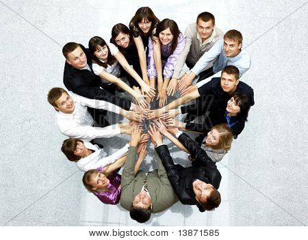 Top view of business people with their hands together in a circle poster