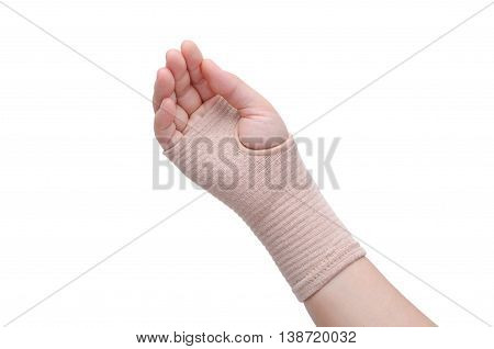Hand with bandage support isolated over white