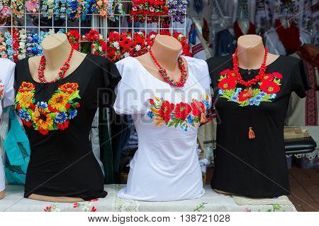VITEBSK BELARUS - JULY 13 2016: Street trade on Slavonic Bazaar Festival in Vitebsk. Clothing with embroidery satin stitch