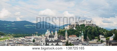 Panoramic view of Salzburg castle (Festung Hohensalzburg) in cloudy day Austria.