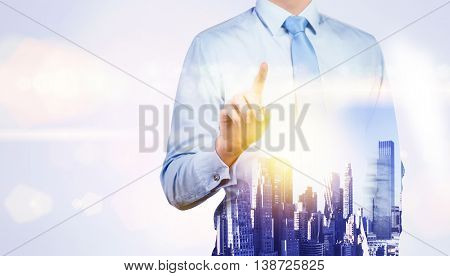 Front view of pointing businessman on New York city background with sunlight. Double exposure