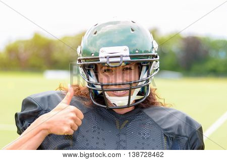 Motivated Young Female American Football Player