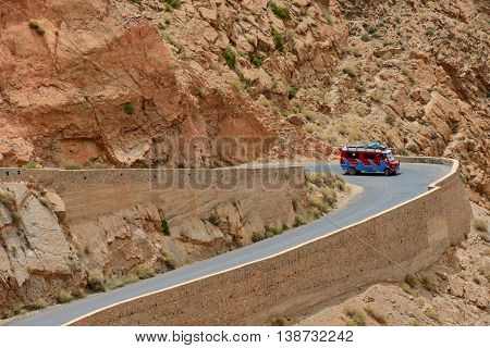 DADES GORGES, MOROCCO - JULY 11: Car on a winding road, July 11, 2013 in Dades Gorges, Morocco. Road in Dades Gorges very popular tourist route in east Morocco.
