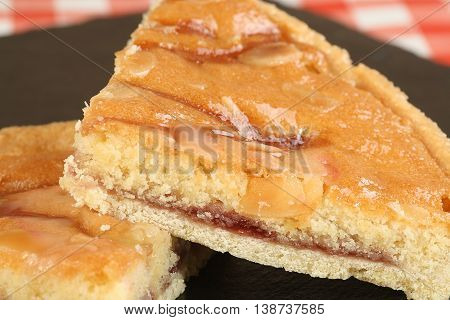 two slices of bakewell pudding on a black plate
