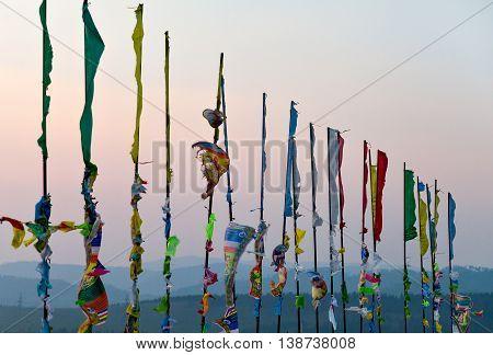 Prayer flags and Hadak at sunset in the Republic of Buryatia. Datsan Rinpoche Bagsha on Bald Mountain in Ulan-Ude, Russia.