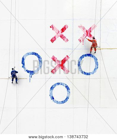 Maintenance workers  play tick-tack-toe  outside a wall