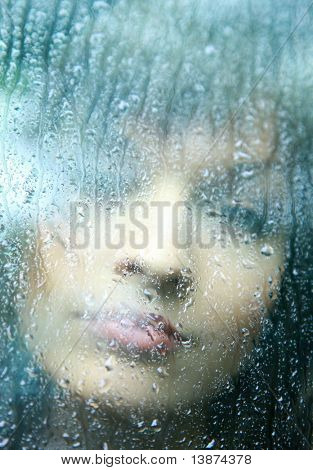Sad young woman and a rain drops poster