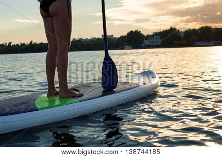 Sup Silhouette Of Young Girl Paddle Boarding At Sunset13